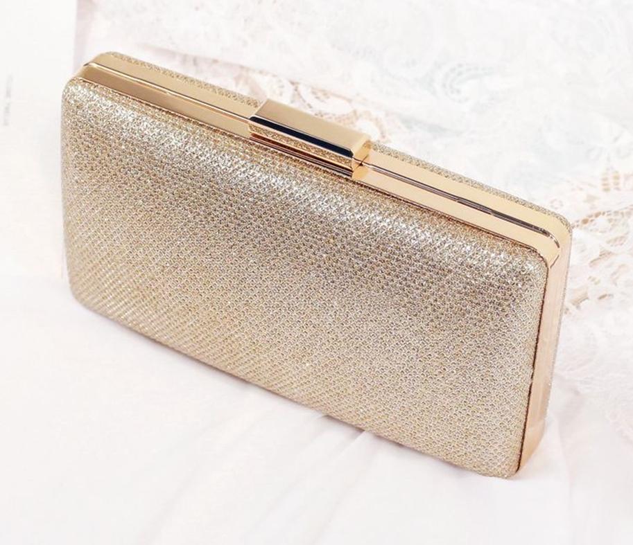 กระเป๋าถือออกงานสีทอง แต่งเพชรคริสตัล