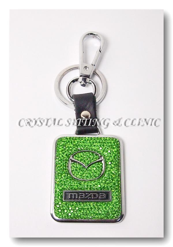 พวงกุญแจรถยนต์ยี่ห้อ MAZDA สีเขียว Peridot ( Mazda Keyring in peridot color )